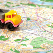 Small car on map — Stock Photo #6132593