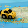 Stock Photo: Small car on map