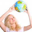 Young blond woman holding a globe — Stock Photo