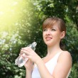 Woman with water bottle — Stock Photo #6132809
