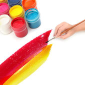 Hand with brush and paint — Stock Photo