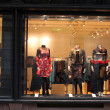Boutique window with dressed mannequins — Stock Photo #6193108