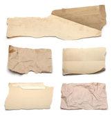 Roztrhané kousky papíru na bílém — Stock fotografie