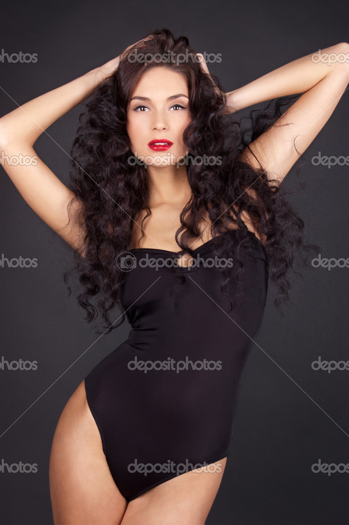 Beautiful sexy woman with long curly hair - Stock Image