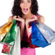Happy beautiful young woman with shopping bags — Stock Photo #5632669