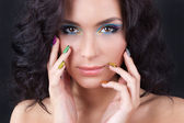 Woman with professional colourful make-up and sparkling manicure — Stock Photo