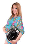 Portrait of happy beautiful pregnant woman with clock — Stock Photo