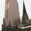 Skyscraper and gothic revival church in Montreal — Stock Photo