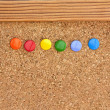 Stock Photo: Drawing pins in cork pinboard