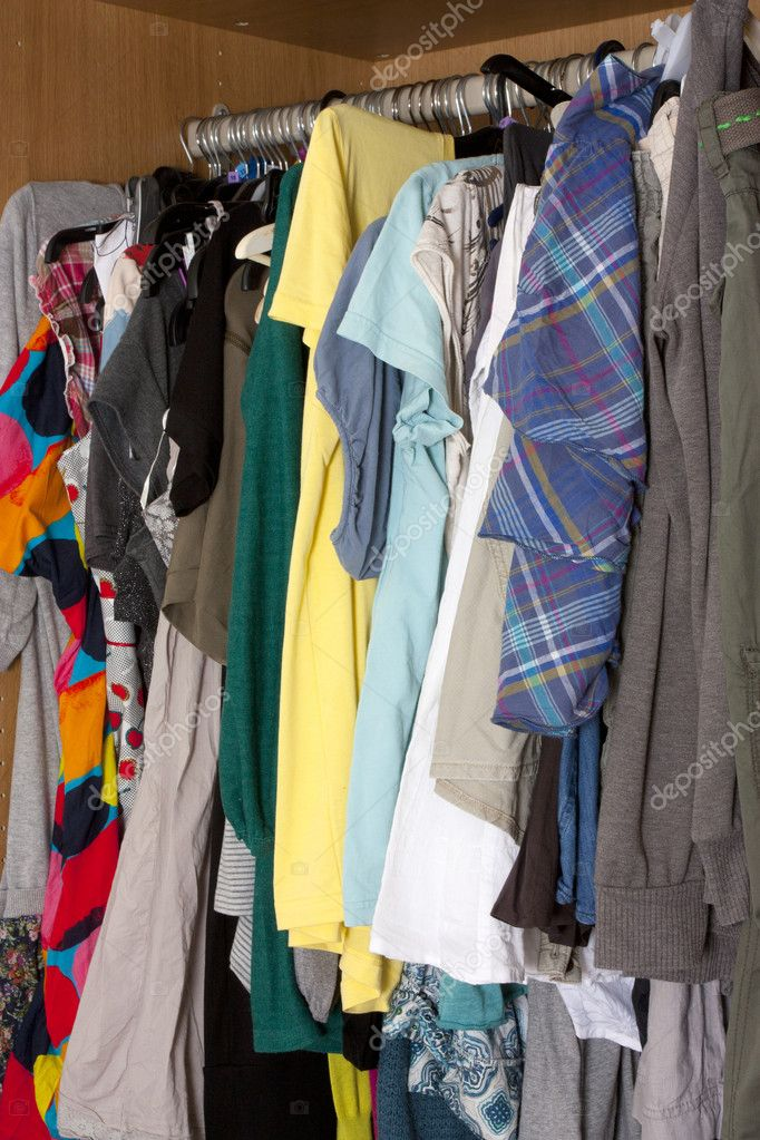 Lots of clothes hanging up in a messy way in a womens wardrobe — Stock Photo #5583882