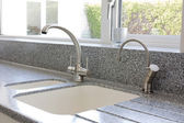 Kitchen mixer tap and sink — Stock Photo
