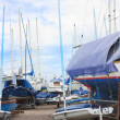 Boats and yachts in a boatyard - Stock Photo
