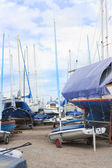 Boats and yachts in a boatyard — Stock Photo