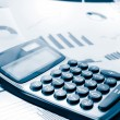 Calculator and graphs dutone for business performance — Stock Photo