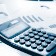 Calculator and graphs dutone for business performance - Stock Photo