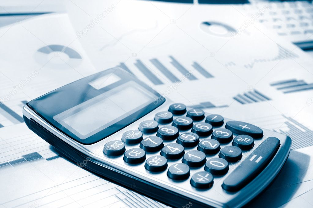 Calculator and graphs representing a business financial performance — Stock Photo #5794671