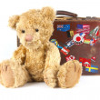 Teddy bear and vintage old suitcase with world stickers — Stock Photo