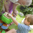 Grandma and children playing — Stock Photo
