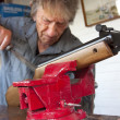 Man repairing a gun in his workshop — ストック写真