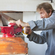Man sawing in workshop, eldery — Foto de Stock