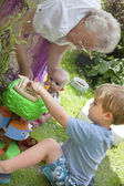 Grandma and children playing — Stock Photo