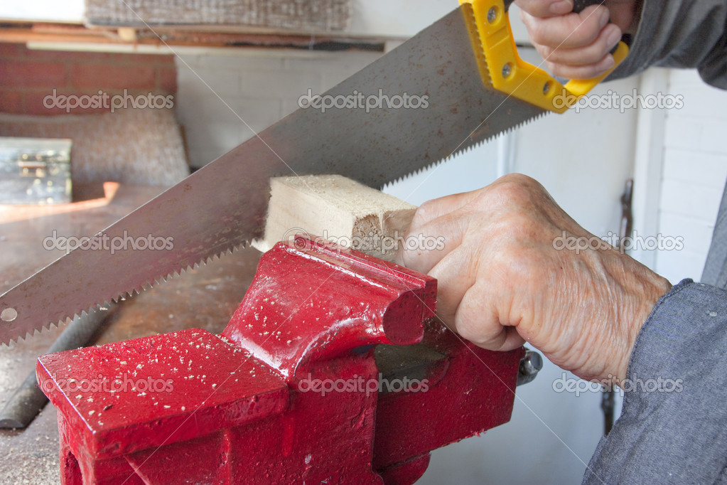 Carenter close up of a red clamp or vice with wood in workshop working — Stock Photo #6047602