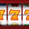 Gambling fruit machine showing a winning line for payout - Stock Photo
