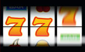 Fruit machine gambling with last line still spinning — Stock Photo