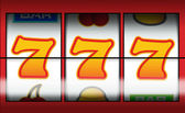Gambling fruit machine showing a winning line for payout — Stock Photo