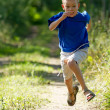 Young boy running in nature — Stock Photo