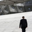 Businessman climbing stairs - Foto de Stock