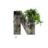 Green ivy on 3d stone letter - n — Stock fotografie