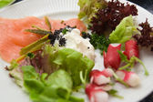 Smoked salmon with salad — Stock Photo