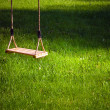 Swing in a garden — Stock Photo