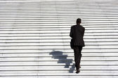 Businessman climbing stairs — Stock Photo