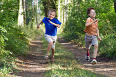 Young children running in nature — Stock Photo