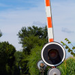 Level crossing gate - Stock Photo
