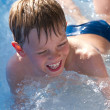 Child playing in the water — Stock Photo