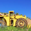 Old  yellow bulldozer near marble quarry. — Stock Photo
