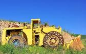 Old yellow bulldozer near marble quarry. — Stock Photo