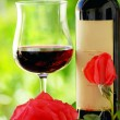 Stock Photo: Red roses and red wine.