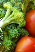 Broccoli and mature tomato. — Stock Photo