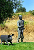 Man and pig statue , Arronches village, Portugal. — Stock Photo