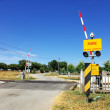 Signs warning on railroad crossing. — Stock Photo