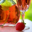 Glass of rose wine and strawberry. — Stock Photo