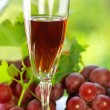 Glass of rose wine and mature grapes. — Stock Photo