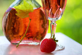 Glass of rose wine and strawberry. — Photo