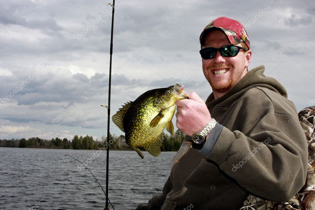 Crappie caught fishing from a boat on a freshwater lake — Stock Photo #5628069