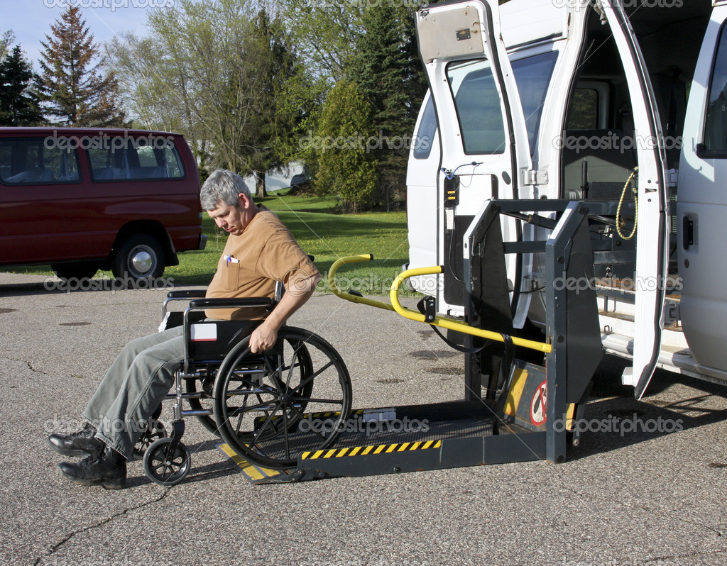 Handicapped man in a wheelchair backing into a vehicle lift  Stock Photo #5725716