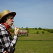 Farmer in straw hat with corn cob pipe — Stock Photo